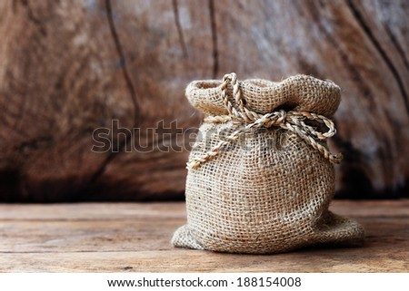 Bags and sacks on the old wood. - stock photo