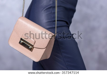 Bags fashion trends. Close up of gorgeous stylish bag. Fashionable woman is holding a trendy bag. Stylish trendy accessories concept - stock photo