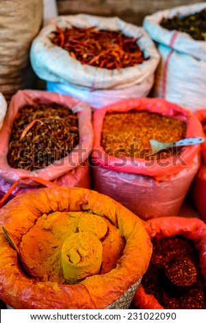 Bags of different spices and chillies in Asian market (Myanmar) - stock photo