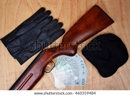 Bags of drugs,  euro money and gun on a wooden table