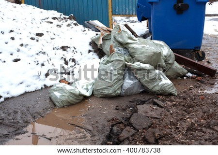 bags of garbage on the street. environmental pollution. - stock photo