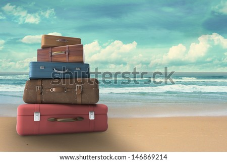 bags on beach, travel concept - stock photo