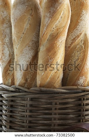 Baguette and basket abstract background - stock photo