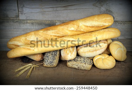 Baguette and various breads - stock photo