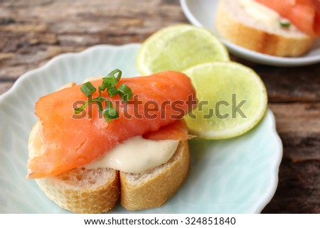 Baguette bread with smoked salmon - stock photo