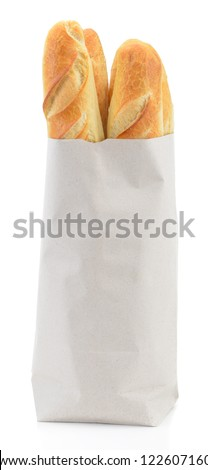 Baguette in paper bag isolated on white background - stock photo