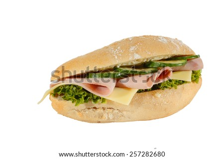 Baguette roll with ham, cheese, lettuce and cucumber slices, isolated - stock photo