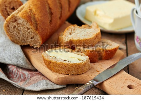 Baguette   with butter - stock photo