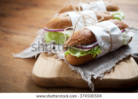 Baguette with ham and cheese - stock photo