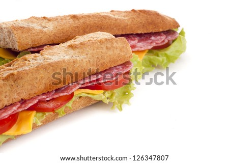 baguette with meat and vegetables over white background