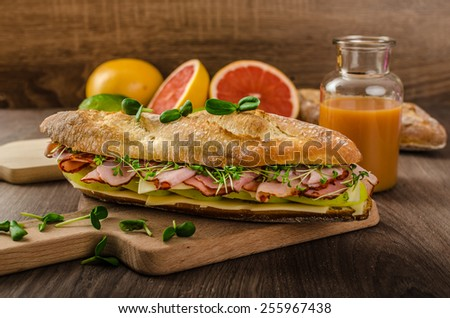 Baguette with smoked rump apples and emmenthal stock photo