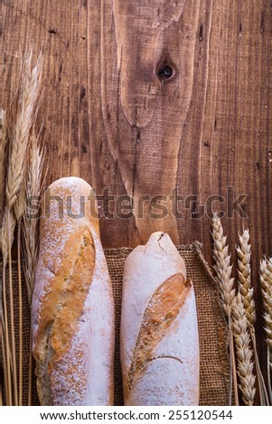 baguettes and ears on vintage board  - stock photo