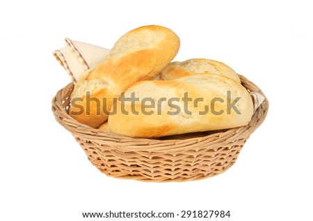 Baguettes in a wicker basket isolated against white - stock photo