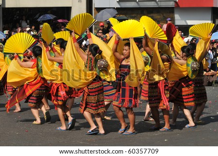 BAGUIO CITY - FEBRUARY 27: Participants perform in the streets February 27, 2010 in Baguio City, Philippines during the Panagbenga 2010 (Annual Flower Festival). - stock photo