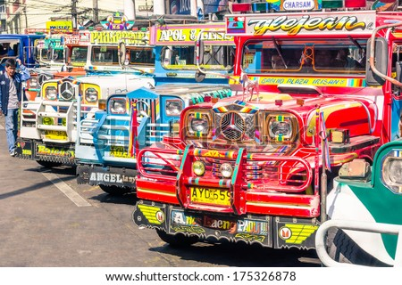 BAGUIO, PHILIPPINES - FEBRUARY 4, 2014: colorful jeepneys at the bus station of the city of Baguio. Inspired from US military jeeps, those are the cheapest and kitschest transportation in the country. - stock photo