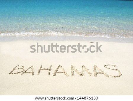 BAHAMAS writing on a desrt beach - stock photo