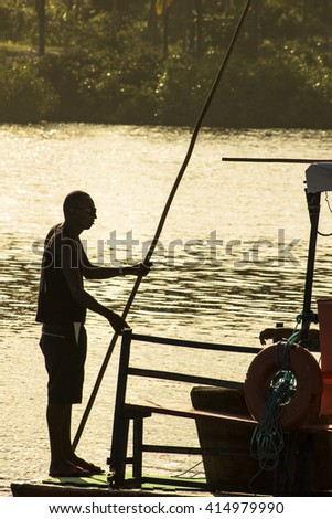 BAHIA, BRAZIL - August 22, 2008: Jangadeiro navigates on Imbassai River, in the Municipality of Mata de Sao Joao, north coast of Bahia
