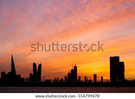 Bahrain skyline and dramatic sky during sunset
