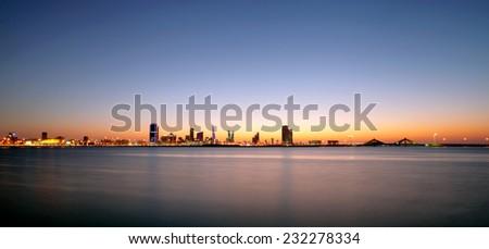 Bahrain skyline during sunset - stock photo