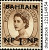 BAHREIN - CIRCA 1957:  Queen Elizabeth II. Stamps of Great Britain surch Bahrein and new value in Indian currency, circa 1957 - stock photo