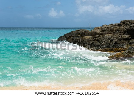 Baie Rouge, the pink sand beach, one of the tourism destinations of Saint Martin island