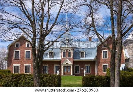 Baie Saint Paul, Canada - May 6 2014: The rectory house of the St Peter and Paul church