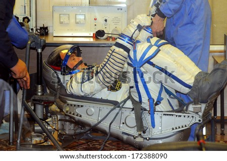 BAIKONUR, KAZAKHSTAN - DECEMBER 9, 2011: Expedition 30 Flight Engineer Andre Kuipers undergoes a leak check of his Russian Sokol launch suit during launch preparation for his flight to ISS on Dec. 21 - stock photo