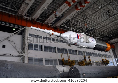 BAIKONUR, KAZAKHSTAN - DECEMBER 18, 2011: Part of Soyuz spacecraft is being relocated inside Integration facility building for further assembly - stock photo