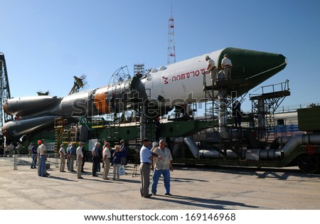 BAIKONUR, KAZAKHSTAN - JUNE 28, 2010: Russian Progress spacecraft has just arrived at the launch pad at Baikonur cosmodrome  to be launched to International space station on the 30th of June, 2010 - stock photo