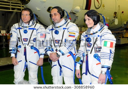 BAIKONUR, KAZAKHSTAN - NOVEMBER 12, 2014: ISS Expedition 42/43 crew T.Virts (left), A.Shkaplerov (center), S.Cristoforetti (right) answer questions from reporters in Integration Facility Building - stock photo