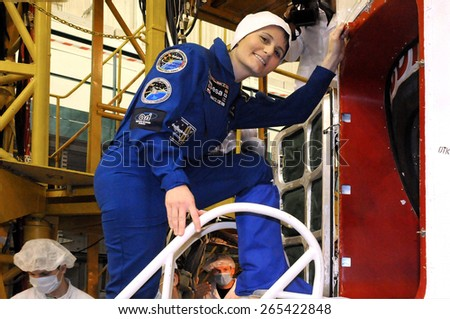 BAIKONUR, KAZAKHSTAN - NOVEMBER 19, 2014:  ISS Expedition 42-43 crewmember Samantha Cristoforetti before getting into the Russian Soyuz TMA-15M spacecraft for the fit check at Baikonur Cosmodrome - stock photo