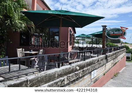 BAILEYS BAY, BERMUDA - SEP 13: The Swizzle Inn in Bermuda, as seen on Sep 13, 2013. It is Bermuda's oldest and most famous pub. It is home to Bermuda's national drink the Rum Swizzle. - stock photo