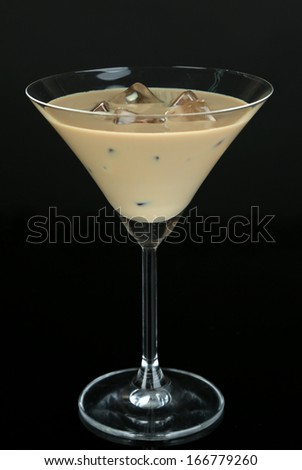 Baileys liqueur in glass isolated on black - stock photo