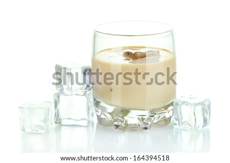 Baileys liqueur in glass isolated on white - stock photo
