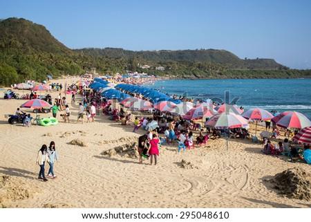 Baishawan (White Sand Beach), Pingtung County, Taiwan - February 28, 2015 : many people go to beach during Chinese new year - stock photo