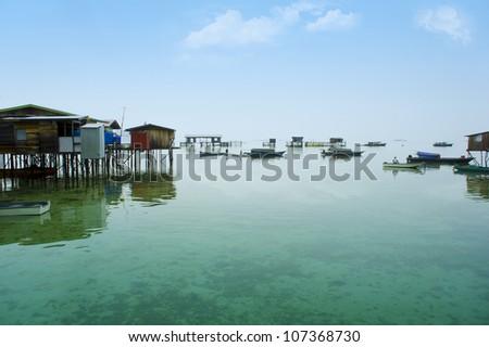 bajau laut village seascape at morning - stock photo