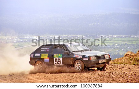 BAKAL, RUSSIA - AUGUST 3: Dmitry Manaev's LADA Samara (No. 59) competes at the annual Rally Southern Ural on August 3, 2007 in Bakal, Satka district, Chelyabinsk region, Russia. - stock photo