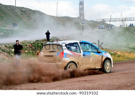 BAKAL, RUSSIA - AUGUST 8: Igor Dautov's CitroeÂ?n C2 (No. 19) competes at the annual Rally Southern Ural on August 8, 2008 in Bakal, Satka district, Chelyabinsk region, Russia. - stock photo