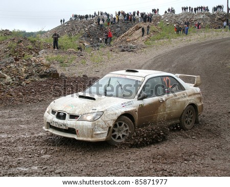 BAKAL, RUSSIA - AUGUST 8: Vladimir Kilunin's Subaru Impreza (No. 12) competes at the annual Rally Southern Ural on August 8, 2009 in Bakal, Satka district, Chelyabinsk region, Russia.