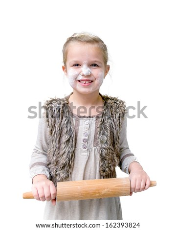 Bake cookies. Funny girl with flour on the face and rolling pin in the hands - stock photo