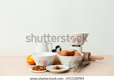 Bake ingredients on a wooden board and white background - stock photo