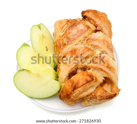 baked apple pie and green apple slices on plate isolated on white  - stock photo