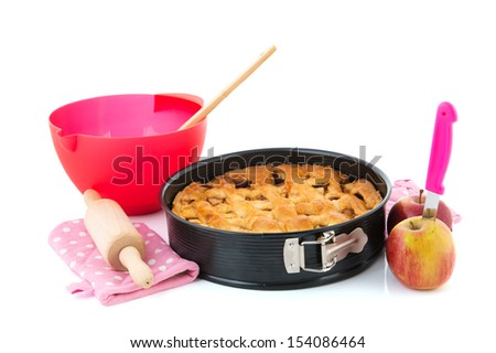Baked apple pie with fresh fruit and kitchen utensils