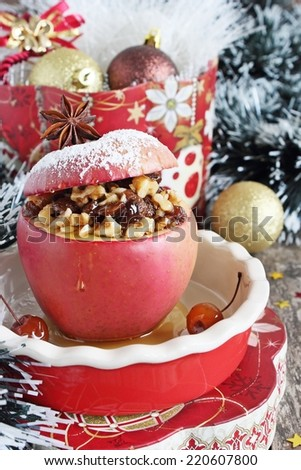 Baked apple stuffed with nuts, raisins and honey.Traditional Christmas dessert.