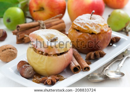 baked apples stuffed with dried fruit, nuts and cottage cheese, horizontal - stock photo
