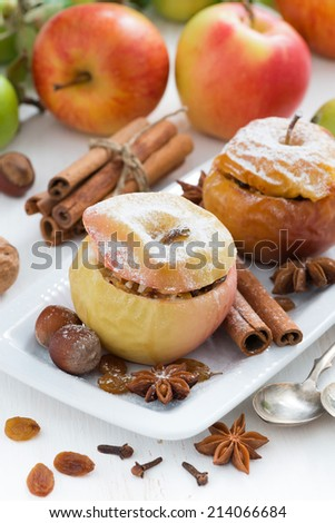 baked apples stuffed with dried fruit, nuts and cottage cheese on plate, vertical - stock photo