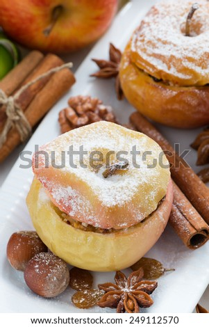 baked apples stuffed with dried fruit, nuts and cottage cheese, top view - stock photo
