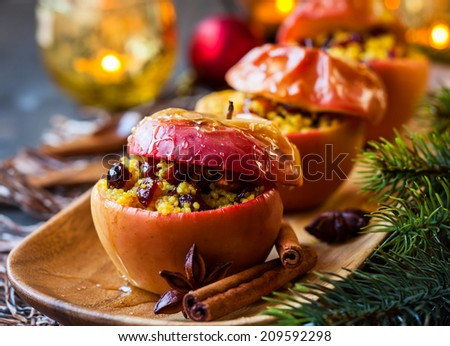 Baked apples with couscous,nuts and dried berries - stock photo