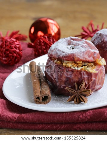 Baked apples with spices (anise, cinnamon) winter holiday dessert - stock photo