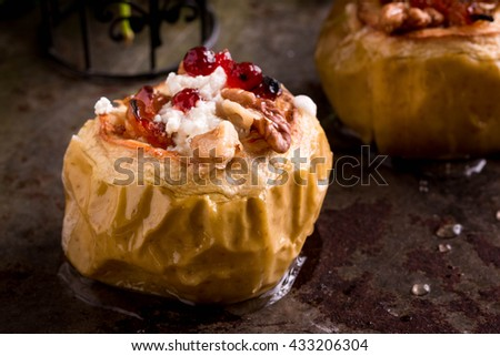 Baked Apples  with Walnuts, Cinnamon, Nutmeg, Honey, Brown Sugar, Oat Crumble and Goat Cheese. Dessert Recipe - stock photo